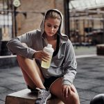 young-woman-in-workout-clothing-drinking-water-at-ernp7af